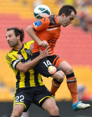 Steven Lustica of the Roar and Andrew Durante of the Phoenix challenge for the ball during the round 21 A-League match ...