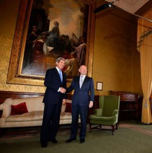 United in their goal: British Foreign Secretary William Hague greets US Secretary of State John Kerry in London.