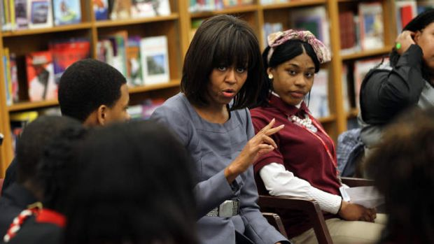 ''There isn't much distance between me and you'': Michelle Obama with Chicago students.