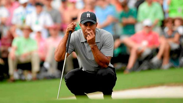 Familiar terriotry: Tiger Woods needed just 30 putts to complete the first round at the US Masters.