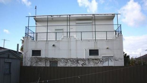 Lock up and leave ... Metal clad exterior of the property in Rowan Street, Glenroy, once owned by Terrence Tognolini.