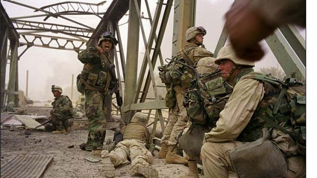 Danger and confusion: Marines cross a bridge over the Diyala River, heading towards Baghdad in the invasion of Iraq.