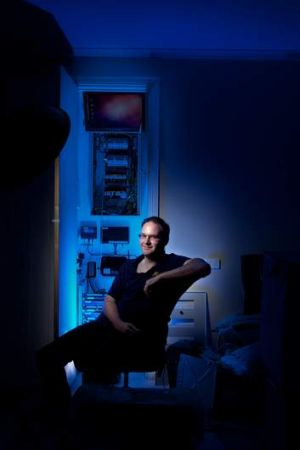 Jon Oxer home automation enthusiast.Pic shows Jon in front of his Home automation switch board.