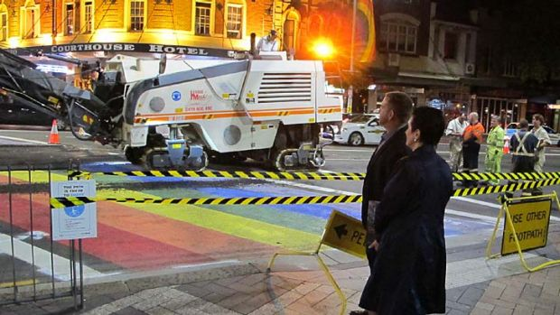 Clover Moore watches the rainbow crossing being ripped up.