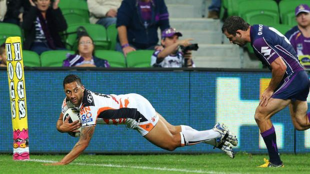 Touchdown: Benji Marshall was starting to find his running game - and the try line - against Melbourne before suffering ...