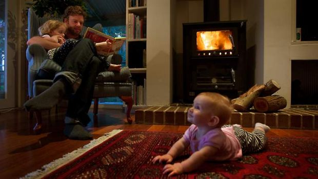 David Glen and his children at home in front of the fire.