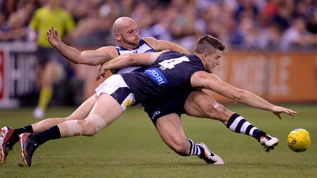 At a stretch: Geelong forward Paul Chapman (left) and Carlton midfielder Bryce Gibbs battle for the ball during the ...