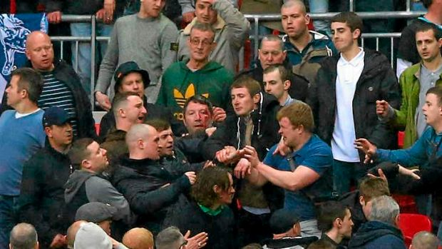 Trouble breaks out between Millwall supporters.