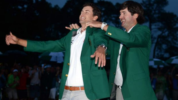 Fitting reward: Bubba Watson with Adam Scott.