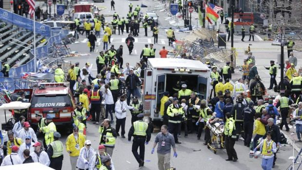 Chaotic scenes as authorities tend to the injured in Boston, where two mystery explosions went off at the end of the ...