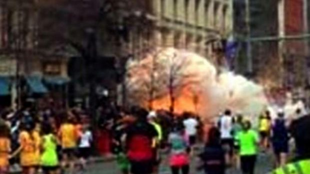 One of the explosions near the marathon finish line was captured on camera as runners headed straight for it.
