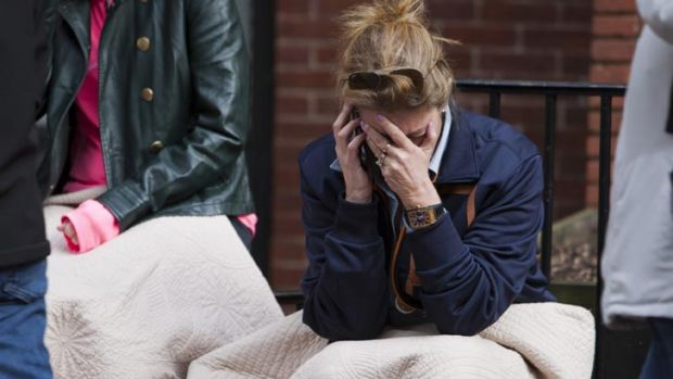Despair ... a woman is clearly distressed as she makes a phone call after the Boston Marathon bombings.