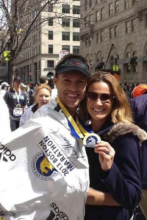 Adam and Angela Clarke moments after he finished the marathon.