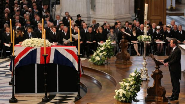 New generation: British Prime Minister David Cameron gives a reading by the coffin.