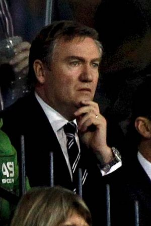 Magpies president Eddie McGuire feels the pinch as he watches his team in a close game.
