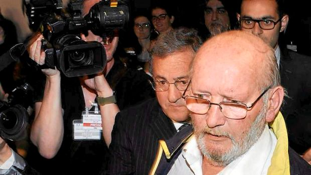Former PIP boss Jean-Claude Mas (right) arrives through a back door at court in Marseille for the opening of his trial ...