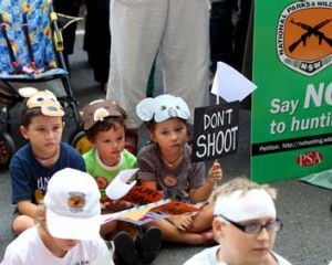 Young children wearing animal masks were part of the protest and rally outside Parliament House.