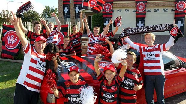 Passionate: Happy Western Sydney Wanderers' supporters gear up for Sunday's grand final against the Central Coast Mariners.