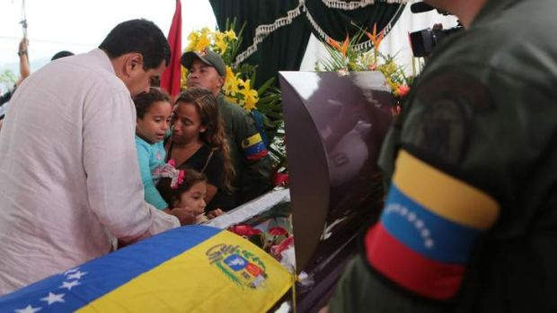 Man of the people: Venezuela's President-elect Nicolas Maduro comforts the family of Jose Luis Ponce, a supporter killed ...