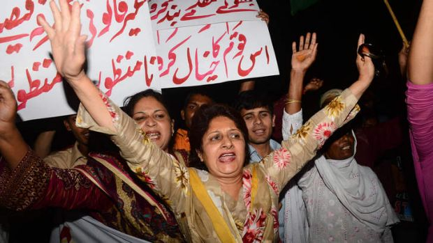 Supporters of former Mr Musharraf demonstrate in Lahore after the order for his arrest was announced.