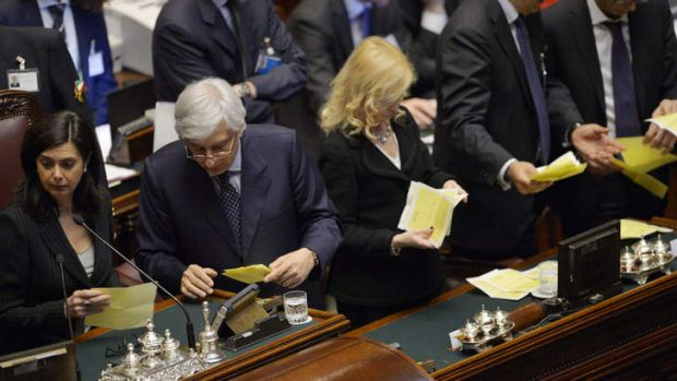 The Italian Parliament President Laura Boldrini, left, begins the vote count.