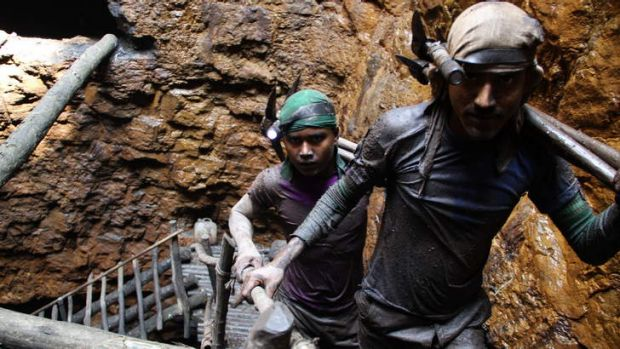 """I don't like this work, but I have to do it"": Gayasuddin, at rear, has been a miner since he was 12."