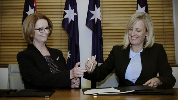 Prime Minister Julia Gillard and ACT Chief Minister Katy Gallagher shared a pen as they signed a National Disability ...