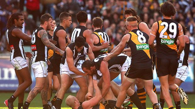 Players turn to wrestling before more than 80,000 fans at the MCG.