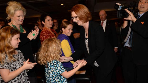 The Prime Minister greets young girls at the ALP State Conference at Moonee Valley on Saturday.