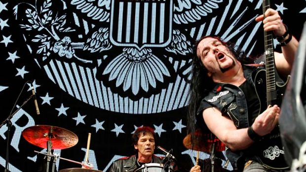 Rocking: Tommy Bolan on guitar and Richie Ramone on drums at ANZ Stadium on Saturday.