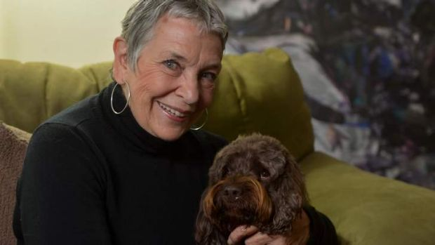 The secret's out: Nancy Cato and her hearing dog, Gilly.