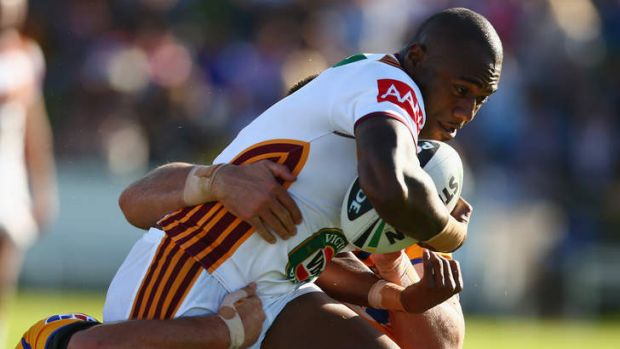 You keep me hanging on: Akuila Uate, playing for Country, is tackled.