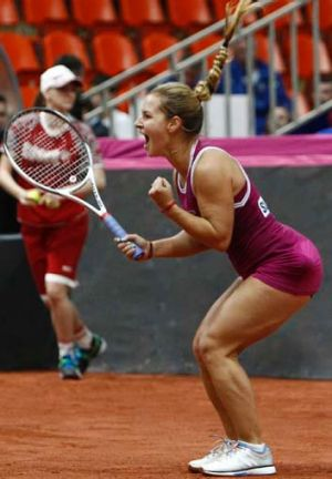 Slovakia's Dominika Cibulkova defeats Russia's Anastasia Pavlyuchenkova during the Fed Cup World Group semi-final in Moscow.