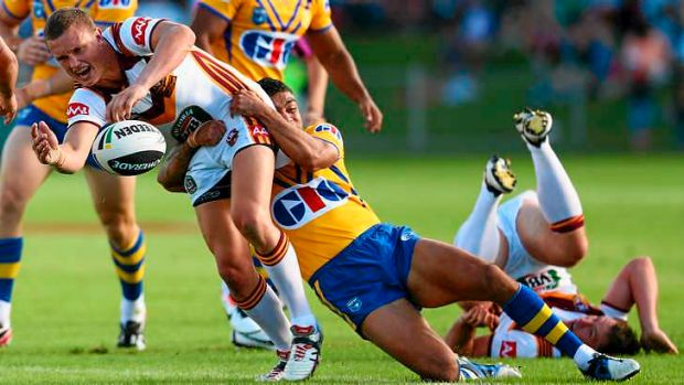 Jack Wighton of Country is tackled by the City defence.