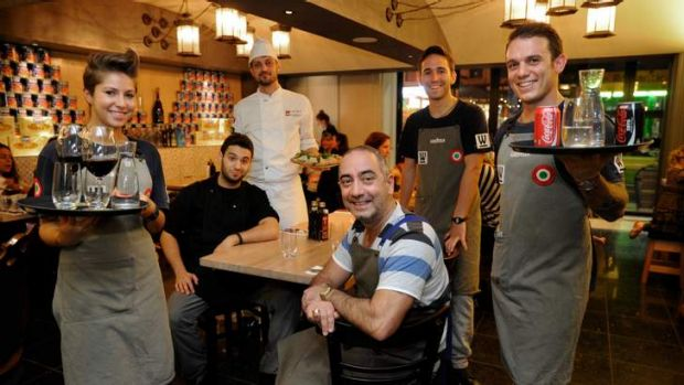 Woodstock Pizzicheria owner Tony Cannata with 457 visa workers at his restaurant.