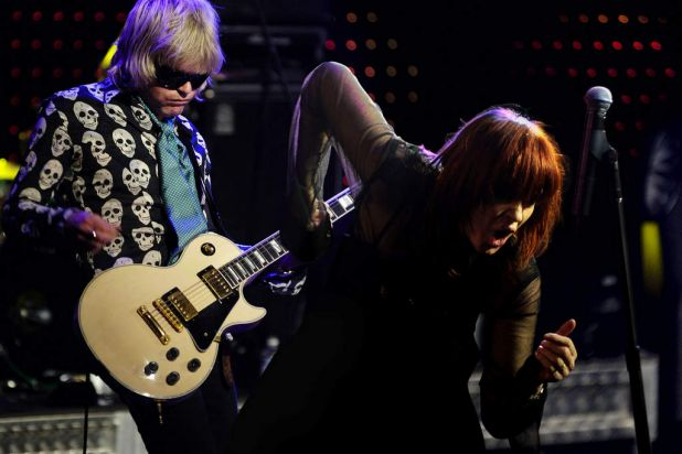 Mark McEntee and Chrissy Amphlett of the Divinyls perform.