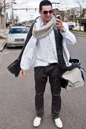 Tamerlan Tsarnaev stops to answer a phone call while walking from his Mercedes.