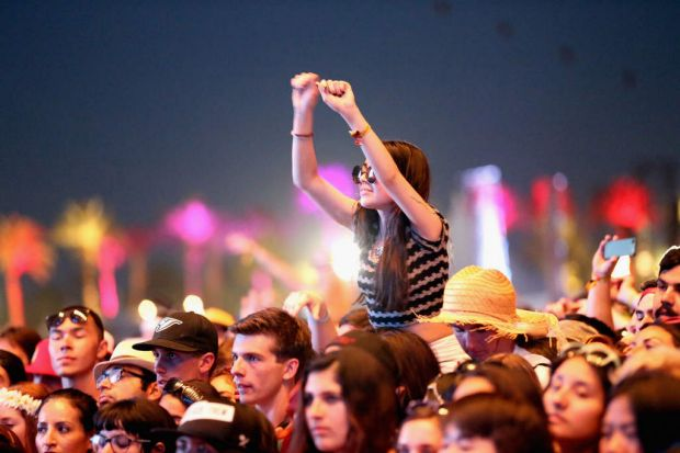 A fan watches Modest Mouse perform during day 1 of the 2013 Coachella Valley Music & Arts Festival - Weekend 2 at the ...