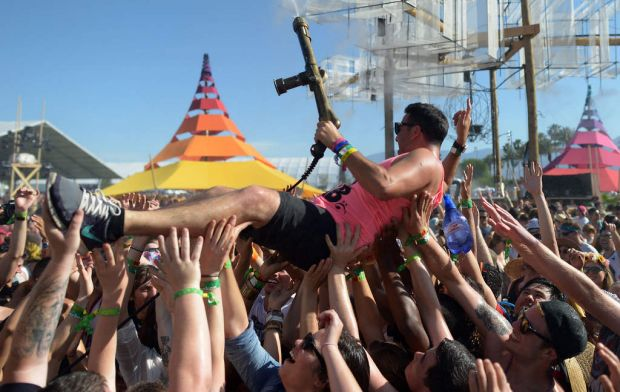 Music fans attend day 2 of the 2013 Coachella Valley Music And Arts Festival at the Empire Polo Club in Indio, California.