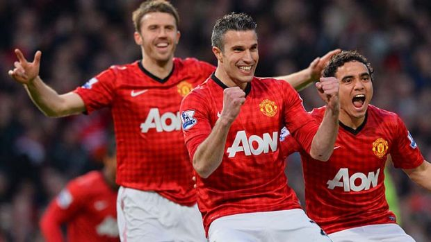 One down, two to go: Robin van Persie, with Michael Carrick (left) and Rafael, celebrates the first goal of his hat-trick.