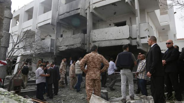 Under fire: Security officers inspect the site of a car bomb that targeted the French embassy.