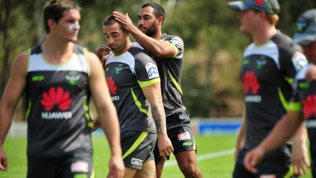 Reece Robinson jumps on the back of Paul Vaughan at Raiders training.