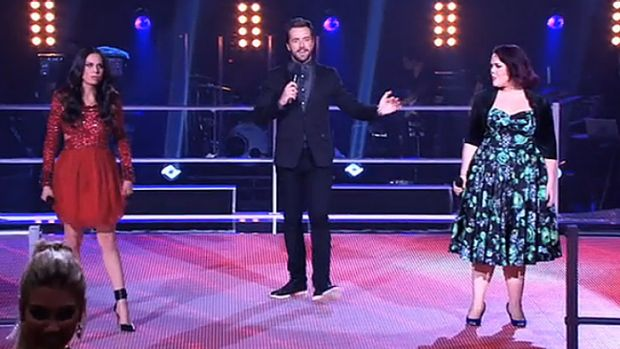 Showdown ... Host Darren McMullen, centre, with the what had to be the act of the evening; Caterina Torres, left, v ...