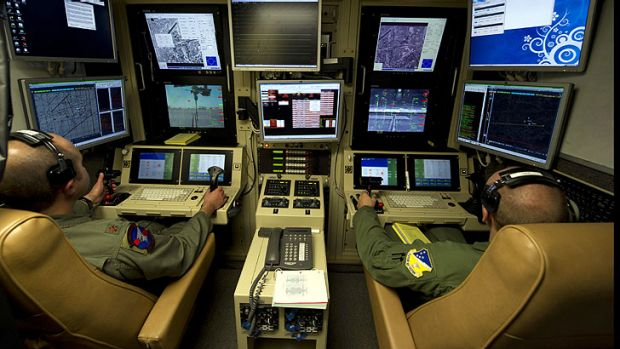 Drone operators fly an MQ-9 Reaper training mission from a ground control station at Holloman Air Force Base in New Mexico.