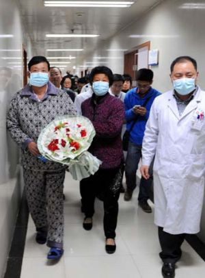 All-clear: A patient (left) from Bozhou, in central China's Anhui province, has been discharged following his recovery ...