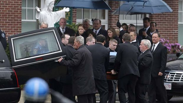 Loved ones mourn: Pallbearers carry the casket of fallen police officer Sean Collier.