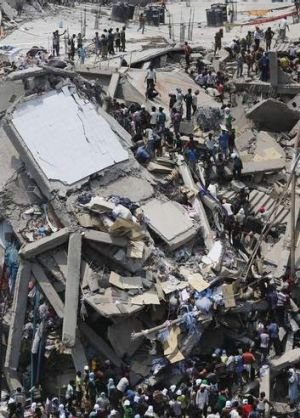 People rescue workers trapped under rubble at the Rana Plaza building after it collapsed, in Savar, 30 km outside Dhaka.