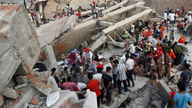People scramble to free trapped garment workers in the Rana Plaza building which collapsed outside Dhaka.