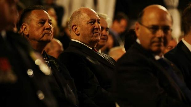 'The 100 years is a very evocative anniversary': Peter Cosgrove, centre, at this year's Anzac Day dawn service at Martin ...