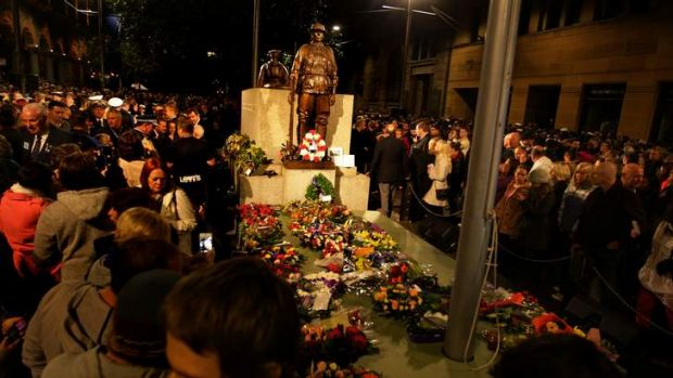 Large crowds pay their respects at the centotaph moments after the 99th ANZAC dawn service at the Martin Place war ...